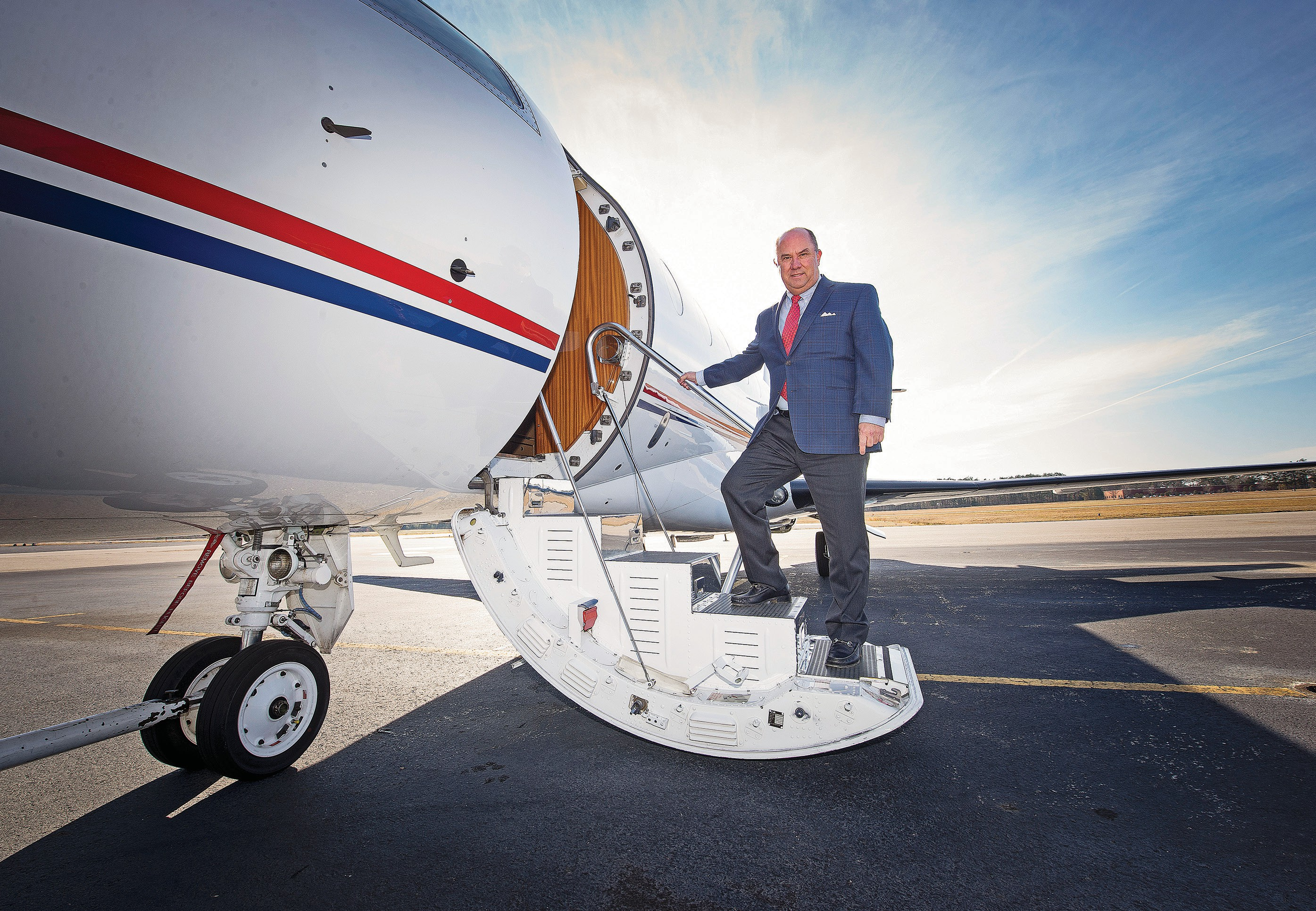 """101f19d84cf Dominion Aviation CEO Thomas T. """"Mike"""" Mickel Jr. boards a Gulfstream  corporate"""