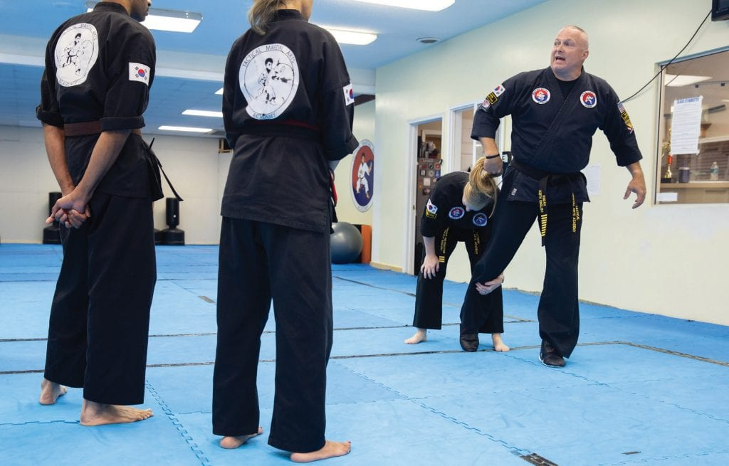 Keith English, lead instructor at the Tactical Martial Arts Academy, and his wife, Kayla English, taught students last week how to respond to an attacker who grabs and pulls you by the hair. PARKER MICHELS-BOYCE