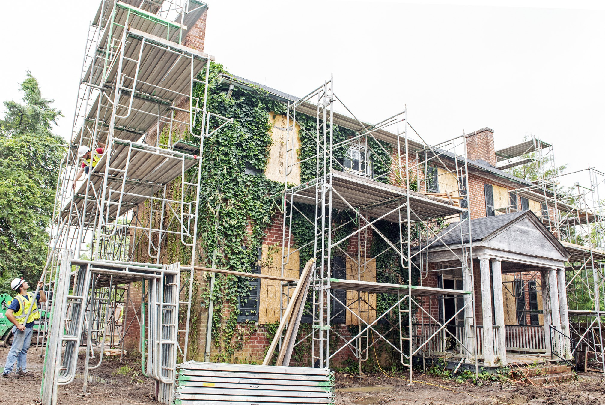 Workers have erected scaffolding on the exterior of a 184-year-old Midlothian house, formerly owned by local teacher Virginia Justis. The 2,900-square-foot structure will be dismantled piece by piece and reconstructed on another site. ASH DANIEL
